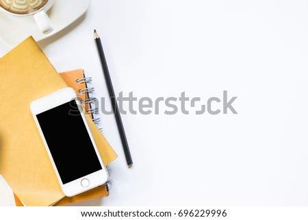 Desk in the office top view.Pencil with notebook and smartphone with coffee on isolated #696229996
