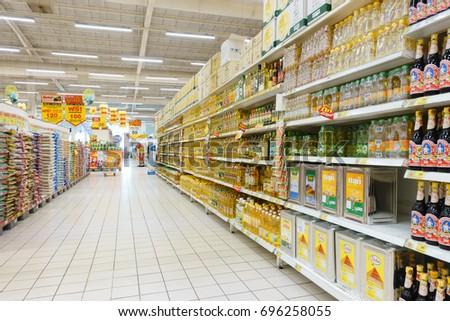 BANGKOK, THAILAND - AUGUST 9, 2017: Various of Cooking Oil on shelf at Big C BangBon, Big C Supercenter general merchandise retailer headquartered in Bangkok, Thailand #696258055