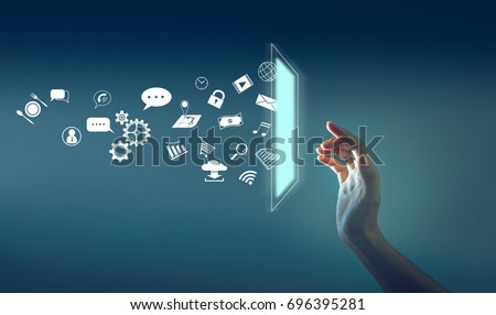 the hand touching the screen with a lot of icon throw out from screen, technology about internet of thing concept. #696395281