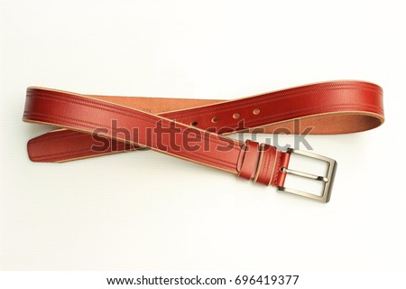 Leather belt for trousers every style. Royalty-Free Stock Photo #696419377
