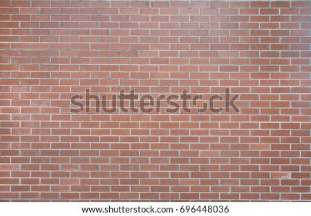 Orange colour vintage brick wall #696448036