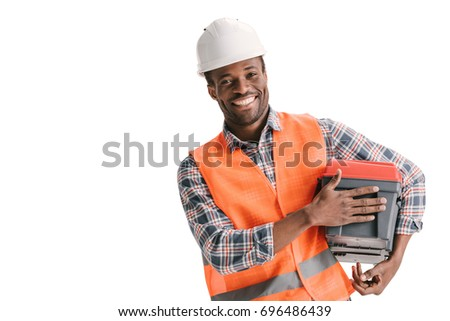 happy african-american construction worker with toolbox isolated on white #696486439
