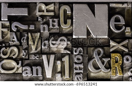Historical letterpress types, also called as lead letters.  These kind of letters were used in Gutenberg presses.  These letters were the beginning of typography. And were used in typesetting #696513241