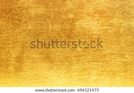 Shiny yellow leaf gold foil texture background #696521473