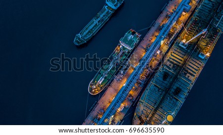 Aerial view oil and gas tanker cargo ship offshore at the port at night, Industry refinery fuel chemical import export business logistic and transportation. #696635590