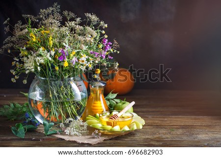Fresh honey, field flowers and ripe apples on a wooden table. #696682903