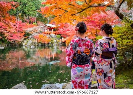 Young women wearing traditional Japanese Kimono at Daigo-ji temple with colorful maple trees in autumn, Daigo-ji temple is famous in autumn color leaves and cherry blossom in spring, Kyoto, Japan. #696687127