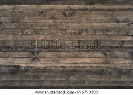 Dark wood texture background surface with old natural pattern. Grunge surface rustic wooden table top view #696790309