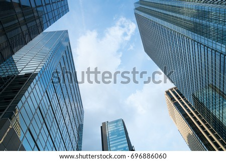A group of modern skyscrapers in the city with beautiful sky and clouds. #696886060