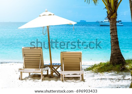 comfortable chair on the beach, modern umbrella, clear sky and sea, copy space. #696903433