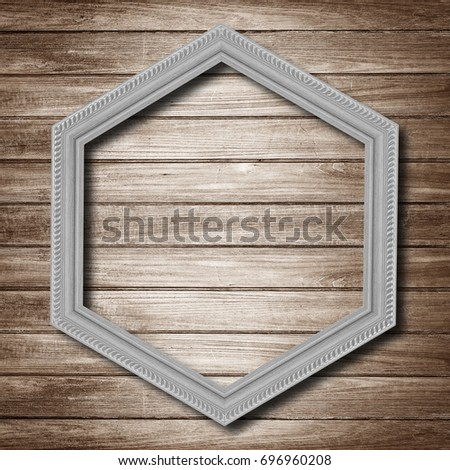gray wooden hexagonal frame isolated on wood  background.