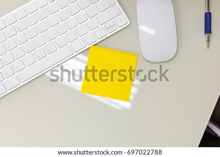 A Empty yellow sticky note on work business desk. #697022788