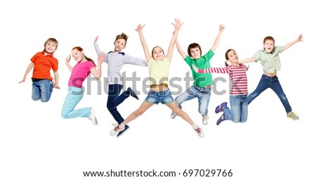 Group of happy, cheerful children jumping at isolated white studio background. Childhood and freedom, active lifestyle concept, copy space #697029766