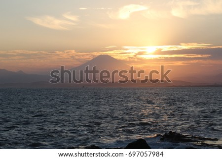 Mt. Fuji silhouette and sunset at Enoshima, Japan #697057984