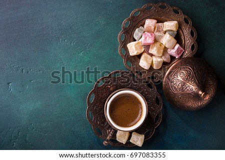 Traditional turkish coffee  and turkish delight on dark green wooden background. Flat lay. #697083355