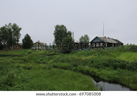 View of the river and old Pomor houses #697085008