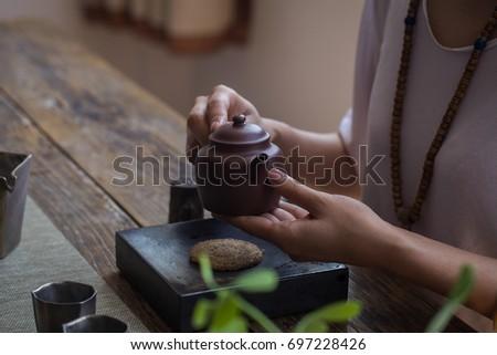 Dark-red enameled pottery teapot #697228426