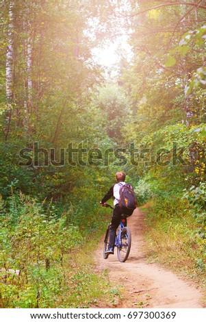 Cyclist Riding the Bike  #697300369