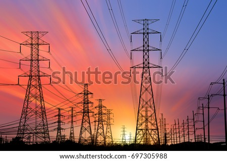 Silhouette High voltage electric tower on sunset time and sky on sunset time background. #697305988