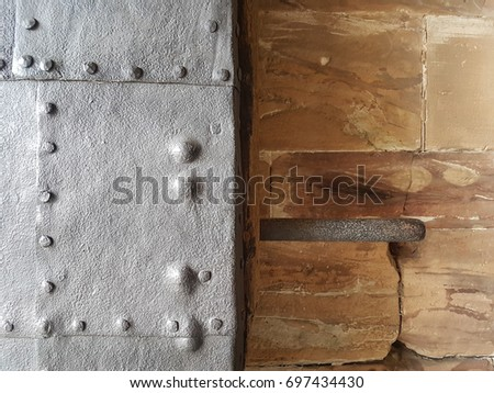 old wood and metal texture on a castle #697434430
