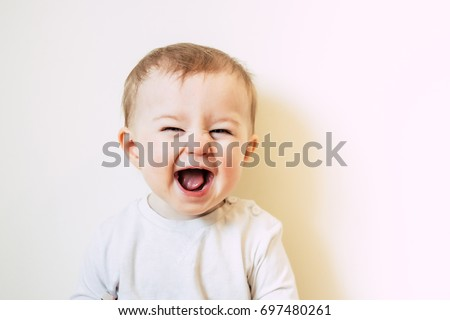 Baby with flu laughing Royalty-Free Stock Photo #697480261