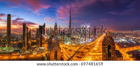 Dubai skyline at sunset Royalty-Free Stock Photo #697481659