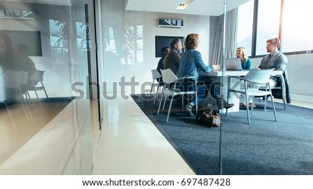 Group of business people having discussion in conference room. Creative business team brainstorming over new project. Royalty-Free Stock Photo #697487428