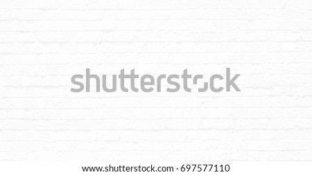 White black and gray horizontal brick wall. Old uneven textured surface on a building in the city. Urban background in grayscale. White painted bricks. #697577110