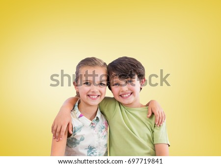 Digital composite of Boy and girl hugging in front of yellow background #697719841