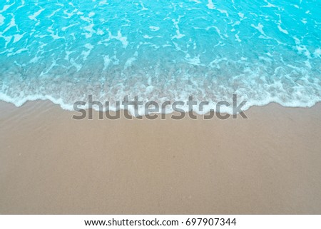 The blue sea soft wave on the sand are continuously and beautifully touching the shore. To relax on holidays and clear sky. #697907344