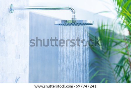 Outdoor rain shower in the beach for swimming pool.Saving water.Summer season.Rain shower.bathroom clean.Hygiene water saving.natural power energy.Sanitize.environment.water day.Ecology.Fresh image. Royalty-Free Stock Photo #697947241