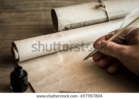 Hand writing with old quill pen on the old paper. Historical atmosphere. Empty place for a text. #697987804