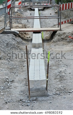 Ground-works for a new Road Pavement with Concrete Paving Stones, replacing the old Asphalt Road Surface #698083192
