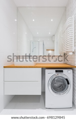 White bathroom with countertop basin, mirror and washer #698129845