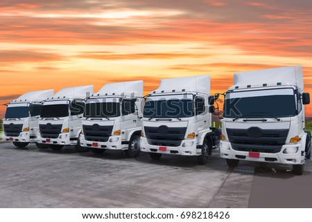 New manufactured of truck fleet with beautiful sky sunset time. #698218426