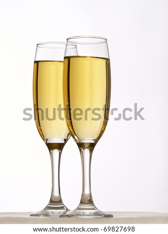 Two champagne glasses in toast #69827698