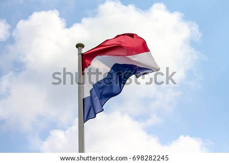 The Netherlands / Holland / Dutch flag waving #698282245