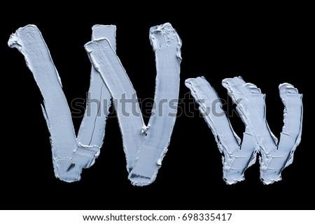 Alphabet.Oil paint.Letter W on a black #698335417