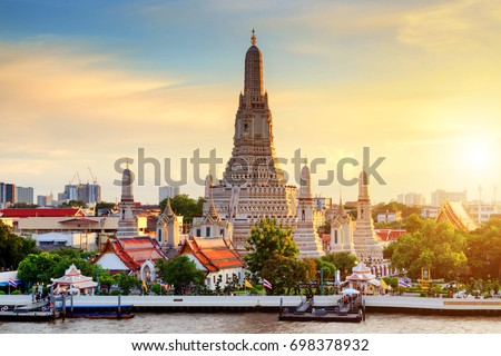 Wat Arun Temple at sunset in bangkok Thailand. Wat Arun is a Buddhist temple in Bangkok Yai district of Bangkok, Thailand, Wat Arun is among the best known of Thailand's landmarks #698378932