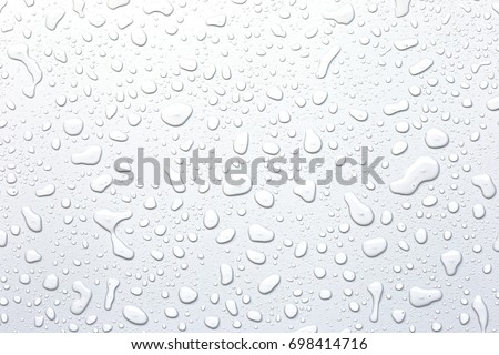 Water droplets on a gray background Royalty-Free Stock Photo #698414716