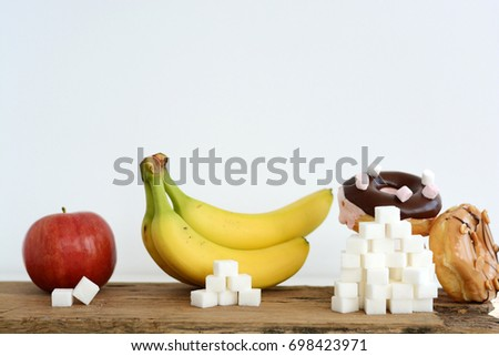 Comparing and analyzing the quantity of sugar contained by fruits and sweets #698423971