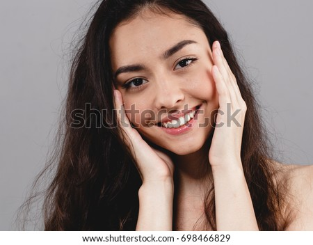 Beauty Woman face Portrait. Beautiful model Girl with Perfect Fresh Clean Skin color lips purple red. Healthy teeth smile Youth and Skin Care Concept. #698466829
