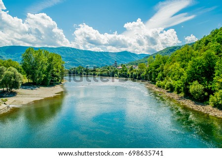Majestic look to the River in eastern Serbia. Beautiful landscape include sky, clouds, mountains, river, forest, stone coast and reflection.  #698635741