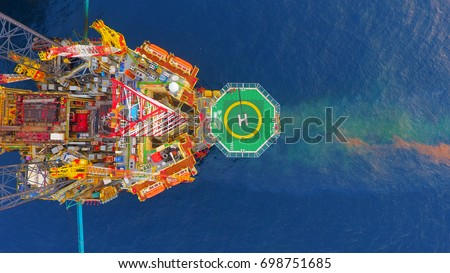 Areal photography from top view of jack up rig scenery with blue ocean view. Royalty-Free Stock Photo #698751685