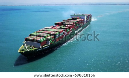 Haifa, Israel - 18 Aug, 2017: a huge big large container ship sails on open water fully loaded with containers and cargo - aerial  view #698818156