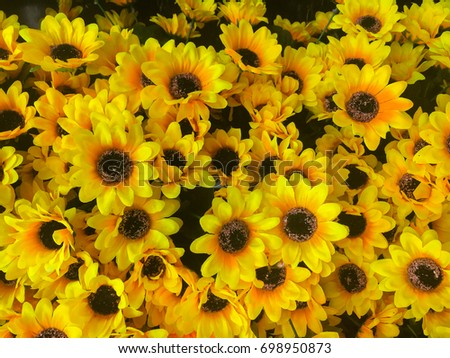 Marigold, plastic yellow flowers by handmade for decoration. #698950873