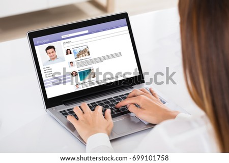 Close-up Of A Businesswoman Chatting On Social Website With Laptop #699101758