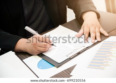 Businessman signing an official document #699210556