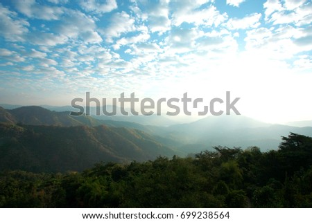 landscape with beautiful clouds and mountain views, real scene without any light effects #699238564