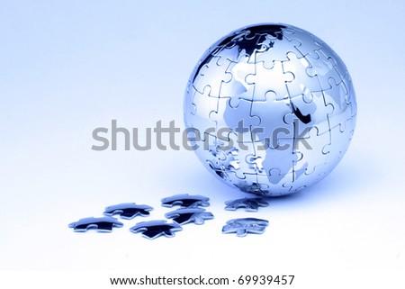 Jigsaw globe puzzle on white #69939457